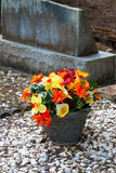 Colorful flowers outside tombstone Stock Photos