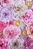 Colorful flowers paper background. Red, pink, purple, brown, yellow and peach handmade paper roses.  stock image