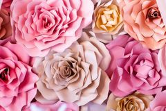 Colorful flowers paper background. Red, pink, purple, brown, yellow and peach handmade paper roses.  royalty free stock photos