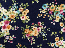 colorful rose flowers pattern on black fabric background Royalty Free Stock Photography