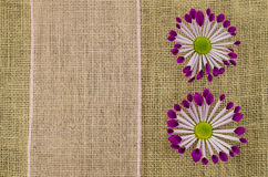 Colorful flowers with pink ribbon on linen background Royalty Free Stock Photography