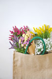 Colorful Flowers in Shopping Bag on White Background Royalty Free Stock Images