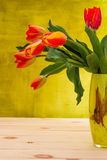 Colorful flowers tulips in yellow vase Royalty Free Stock Image