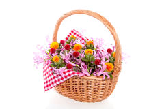 Colorful flowers in a wicker basket Royalty Free Stock Images