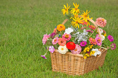 Colorful flowers in a wicker basket Stock Photo