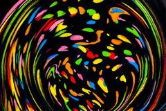 Colorful Flowing Paint. Colorful abstract acrylic painting on water. Natural dynamic mixture of oil colored pigments fluid spots on black background. Naturally Stock Illustration