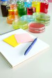 Colorful fluid and note book in glass ware Stock Image