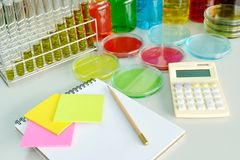 Colorful fluid and note book in glass ware Royalty Free Stock Image