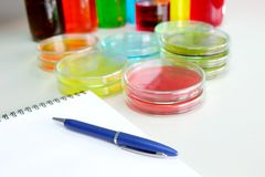 Colorful fluid and note book in glass ware Stock Photo