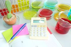 Colorful fluid and note book in glass ware Stock Images
