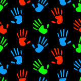 Colorful fluorescent human hands prints on black seamless pattern, vector. Background Stock Photography