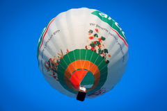 Colorful flying balloon in blue sky Royalty Free Stock Photography