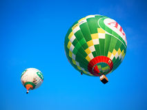 Colorful flying balloons in blue sky Royalty Free Stock Images