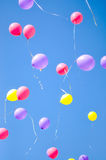 Colorful flying balloons flying to the sky Stock Photography