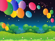 Colorful flying balloons at the hill Royalty Free Stock Image
