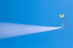 Colorful flying kite in the blue sky Stock Photo