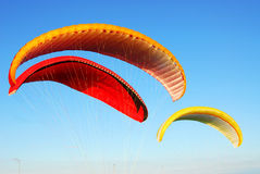Colorful flying parachutes Stock Image