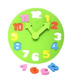 Colorful foam clockface with detachable parts Stock Photos