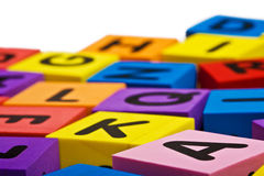 Colorful foam letter blocks stock photos