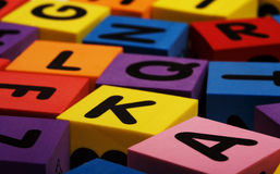 Colorful foam letter blocks Royalty Free Stock Photography