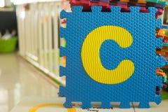 Colorful foam puzzle letters, alphabet C Stock Photography