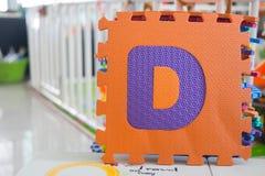 Colorful foam puzzle letters, alphabet D Royalty Free Stock Image