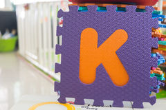 Colorful foam puzzle letters, alphabet K Royalty Free Stock Photo