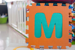 Colorful foam puzzle letters, alphabet M Royalty Free Stock Images