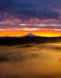 Colorful Foggy Sunrise over Sandy River Valley in Oregon. Colorful Sunrise and Rolling Fog over Sandy River Valley in Oregon Royalty Free Stock Images