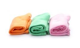 Socks. Colorful folded socks isolated on white background Stock Photo