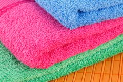 Towels. Colorful folded towels closeup picture Stock Photos