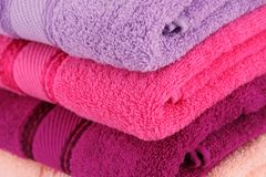 Towels. Colorful folded towels stack closeup picture Stock Image