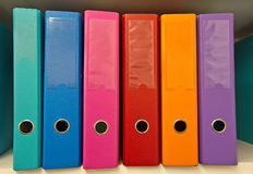 Colorful folders. Colorful binders on the shelf Stock Image
