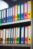 Colorful folders on bookshelf Royalty Free Stock Photos