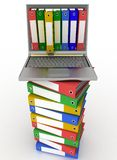 Colorful folders and modern laptop. Colorful folders next to a modern laptop Stock Photos
