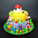 Colorful fondant cake with animals figurines. Beautifully crafted cake with little animals fondant figurines Stock Image