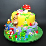Colorful fondant cake with animals figurines. Beautifully crafted cake with little animals fondant figurines Stock Photos
