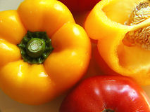 Colorful Food. Yellow peppers and red tomato Royalty Free Stock Image