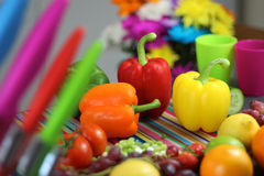 Colorful food preperation. Peppers, fruit and vegetables Stock Photos