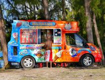 Food Truck, Fast Food, Food Beverages. Colorful food truck at the seaside, Mauritius Island. Fast Food delivery. Food Beverages mobile vehicle royalty free stock image