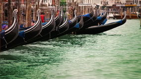 Colorful footage of Venecian gondolas rocking on the water stock video footage