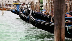 Colorful footage of Venecian gondolas rocking on the water stock video