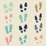 Colorful footprints - female, male and sport shoe. S footmarks. Rubber shoe sole print. Vector illustration Stock Photography