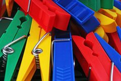 Colorful forecaps tweezers clips as background. Clothespin clothes pin colorful clothespeg red yellow blue clothes peg Royalty Free Stock Photo