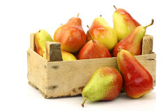 colorful Forelle pears in a wooden crate Royalty Free Stock Image