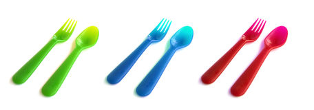Colorful forks and spoons Stock Photos