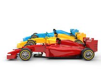 Colorful formula one cars - side view Royalty Free Stock Photo