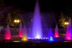 Colorful fountain. At night in the city stock image