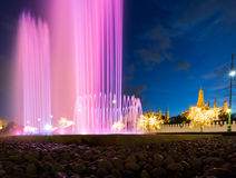 Colorful fountain behind the buddha temple Stock Images