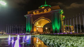 Colorful fountain at the gate to Emirates Palace night timelapse, UAE. stock video footage